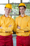 Manual workers standing with arms crossed Royalty Free Stock Images
