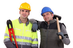 Manual workers stood together Stock Photo