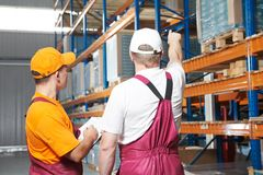 Manual workers in warehouse Stock Images