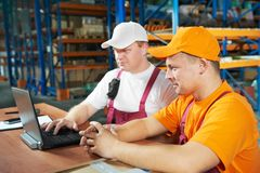 Manual workers in warehouse Royalty Free Stock Photography