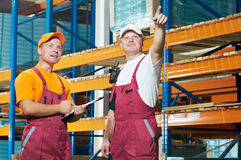 Manual workers in warehouse Stock Photos