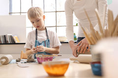 Manual workshops for children, clay molding. Children clay from the clay in the studio of artistic ceramics Royalty Free Stock Photo
