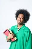 Manuale della holding dell'allievo dell'afroamericano Fotografia Stock Libera da Diritti