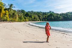 Manuel Antonio, Costa Rica - Girl walking at beautiful tropical beach stock photography