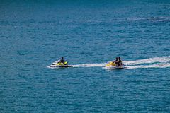 MANUEL ANTONIO, COSTA RICA - MAY 13, 2016: Jet ski riders in National Park Manuel Antonio, Costa Ri. Ca royalty free stock photos