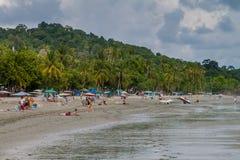 MANUEL ANTONIO, COSTA RICA - MAY 13, 2016: People on a beach in Manuel Antonio village, Costa Ri. Ca royalty free stock images