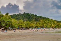 MANUEL ANTONIO, COSTA RICA - MAY 13, 2016: People on a beach in Manuel Antonio village, Costa Ri. Ca royalty free stock image