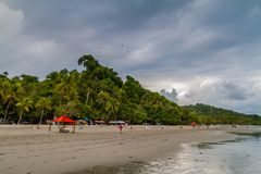 MANUEL ANTONIO, COSTA RICA - MAY 13, 2016: People on a beach in Manuel Antonio village, Costa Ri. Ca stock photography