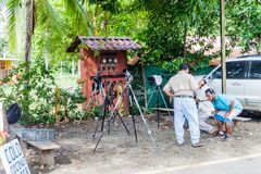 MANUEL ANTONIO, COSTA RICA - MAY 13, 2016: Telescopes of nature guides by the gate to the National Park Manuel Antonio. Costa Rica stock photography