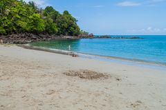 MANUEL ANTONIO, COSTA RICA - MAY 13, 2016: Tourists on a beach in National Park Manuel Antonio, Costa Ri. Ca stock photography
