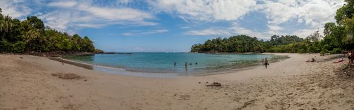 MANUEL ANTONIO, COSTA RICA - MAY 13, 2016: Tourists on a beach in National Park Manuel Antonio, Costa Ri. Ca stock images