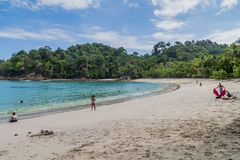MANUEL ANTONIO, COSTA RICA - MAY 13, 2016: Tourists on a beach in National Park Manuel Antonio, Costa Ri. Ca royalty free stock images