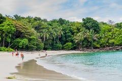 MANUEL ANTONIO, COSTA RICA - MAY 13, 2016: Tourists on a beach in National Park Manuel Antonio, Costa Ri. Ca royalty free stock photo