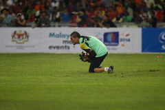 Manuel Pinto. KUALA LUMPUR - AUGUST 09: Barcelona Football Club goalkeeper Manuel Pinto catches the ball during the training session at the Bukit Jalil National Royalty Free Stock Image