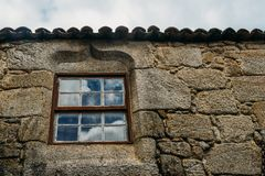 Manueline style window frame in Sortelha, Portugal. Sortelha historical mountain village, built within Medieval fortified walls, included in Portugal`s royalty free stock photography