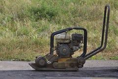 Manuell ramma maskin för vägkonstruktion - telephoto arkivbild