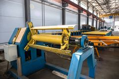 Manufactory workshop, sandwich panel production line for construction. Storage with machine tools, roller conveyor. Industrial manufactory workshop for thermal stock image