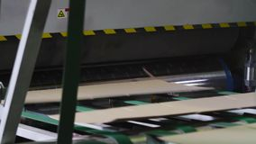 Manufacture of cardboard boxes. Machine for the production of cardboard boxes. Conveyor line for the production of cardboard boxes. Manufacture of cardboard stock video