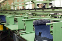 Manufacture of demi-season boots on rubber soles Stock Images