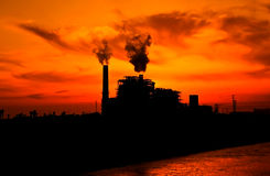 The manufacture of dreams. Picture of a manufacture on the sunset background Royalty Free Stock Image