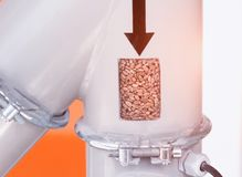 Manufacture of food cereals, in the tube inspection window with cereals, industry, close-up, pearl stock photography
