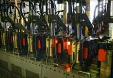 Manufacture of glass bottles. At Factory stock photos
