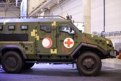 Manufacture of medical armored vehicles at a specialized exhibition. Kiev, Ukraine - October 12, 2017: Manufacture of medical armored vehicles at a specialized Royalty Free Stock Photography