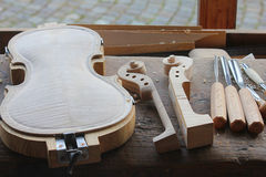 Manufacture of a new violin. The manufacture of a new violin Royalty Free Stock Photos