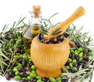 Manufacture of olive oil. Olive oil, fresh olives  and  mortar  over white background Stock Images