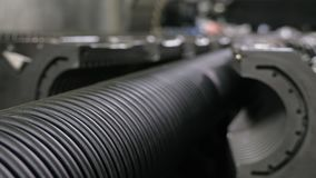 Manufacture of plastic water pipes. Manufacturing of tubes to the factory. The process of making plastic pipes on the. Machine tool with the use of water and stock images