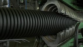 Manufacture of plastic water pipes. Manufacturing of tubes to the factory. The process of making plastic pipes on the. Machine tool with the use of water and stock video