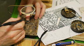Manufacture of printed circuit boards at home, hobbies for men.  Royalty Free Stock Photography