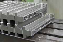 Manufacture  stainless steel array on steel table Royalty Free Stock Photography