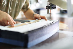 Manufacture of wearing apparel, cutting room. Royalty Free Stock Photo