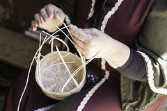 Manufacture of wicker baskets. Detail of a person working with your hands Stock Image