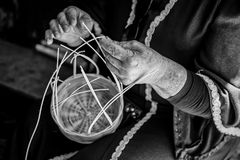 Manufacture of wicker baskets. Detail of a person working with your hands Stock Photos