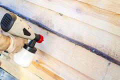 Treatment of the wooden surface with a means of fungus and miPainting of wood spray. Manufacture of wood antiseptic against fungus