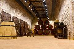 Manufacture of wooden barrels in the factory. Wine barrels with a candle in a cellar Stock Photography