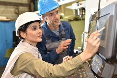 Manufacture workers setting up machinery. Manufacture workers working on electronic machine Royalty Free Stock Photo