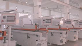 Manufactured woodworking machines stand in a row in stock. A large factory for the production of automated machine tools. Warehouse of woodworking machines stock video footage