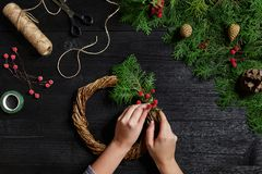 Manufacturer of Christmas decor with their own hands. Christmas wreath for the holiday. The new year celebration. Top Royalty Free Stock Photo