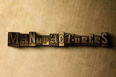 MANUFACTURERS - close-up of grungy vintage typeset word on metal backdrop. Royalty free stock illustration.  Can be used for online banner ads and direct mail Royalty Free Stock Photo