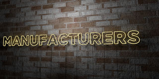 MANUFACTURERS - Glowing Neon Sign on stonework wall - 3D rendered royalty free stock illustration. Can be used for online banner ads and direct mailers Stock Photo