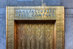 Manufacturers Hanover Trust Company Bank. New York City - June 14, 2017: Manufacturers Hanover Trust Company Bank former bronze door entrance in midtown Royalty Free Stock Image