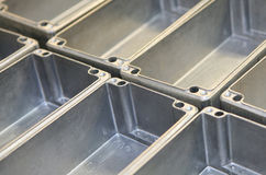 Manufacturing. Detail of aluminum boxes being manufactured into electrical enclosures. Short DOF stock photo