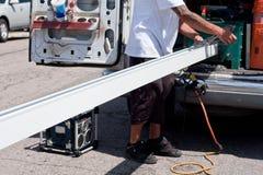 Manufacturing of aluminum rain gutter Stock Images