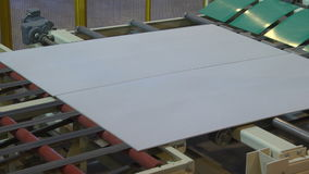 Manufacturing of Gypsum Plasterboard on Plant Equipment stock video footage