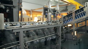 A manufacturing of plastic bottles for water stock video