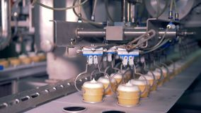 Manufacturing process at ice-cream factory. Ice-cream production process. 4K stock video footage
