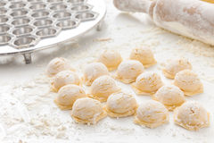Manufacturing process Russian pelmeni Stock Photos